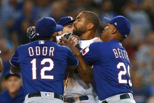 Texas Rangers' Rougned Odor and Adrian Beltre restrain Los Angeles Dodgers' Matt Kemp, center, as Kemp scuffled with Rangers catcher Robinson Chirinos during the third inning of a baseball game, Wednesday, June 13, 2018, in Los Angeles.