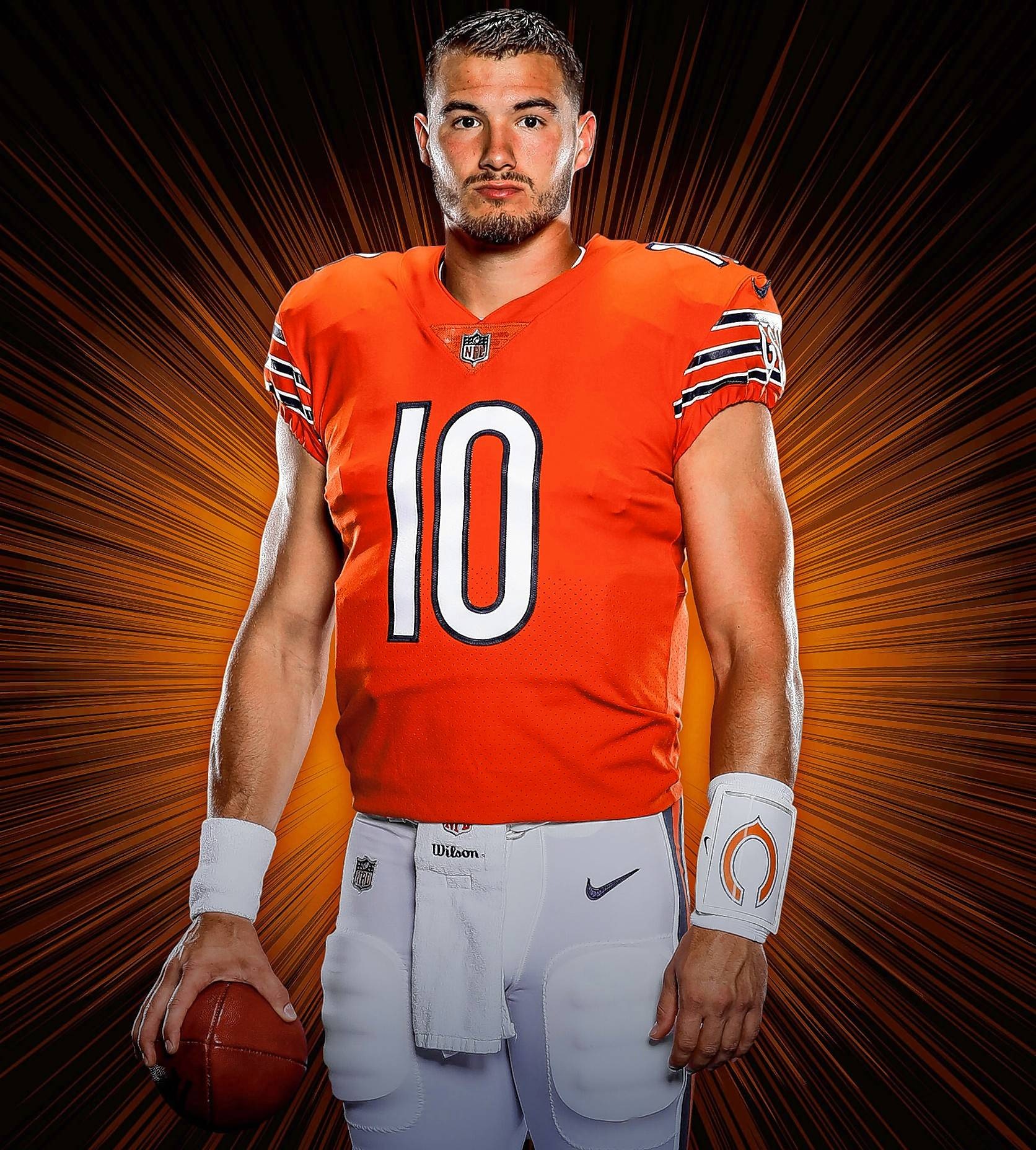 Quarterback Mitch Trubisky models the team's orange jersey for this season.
