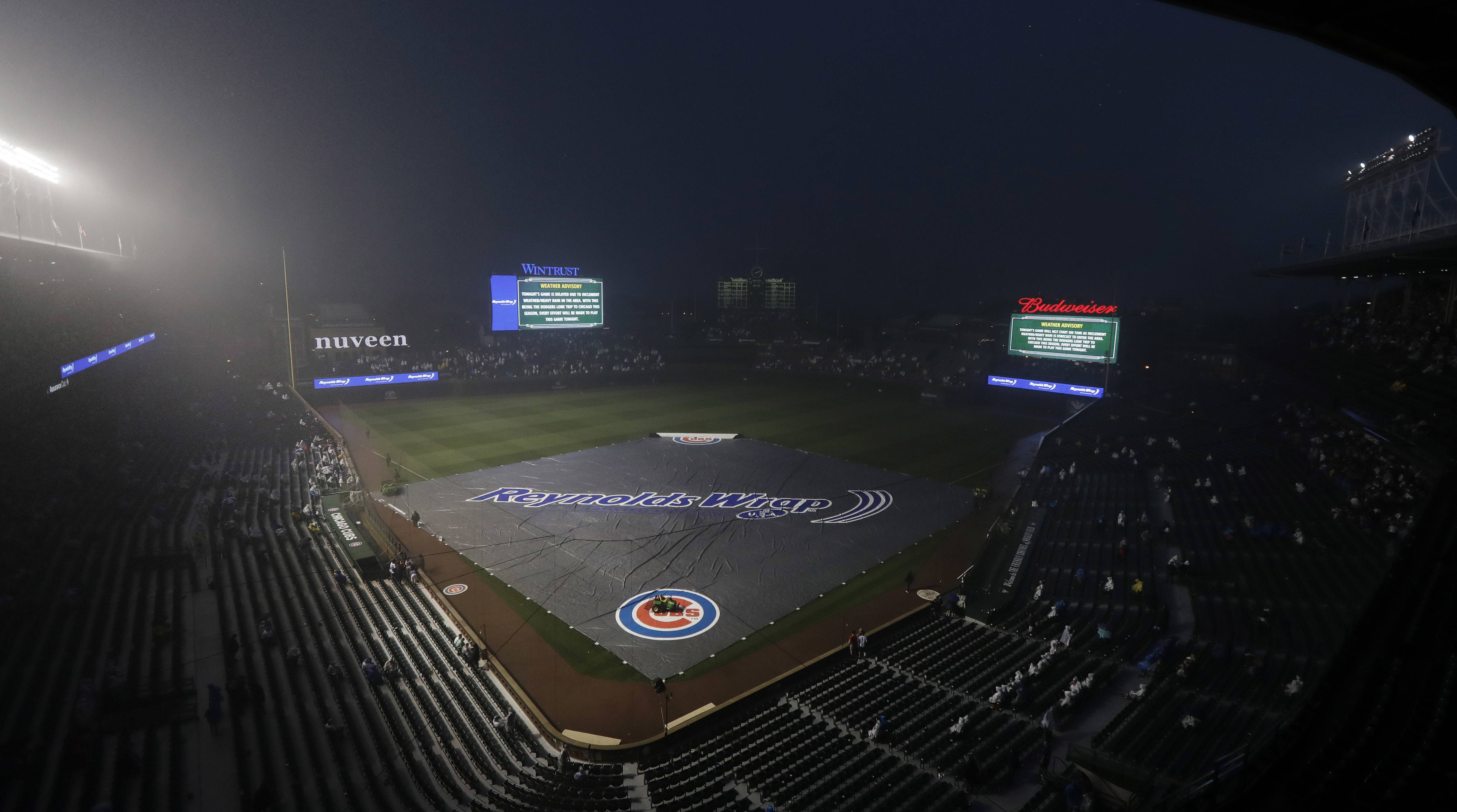 Rain puts Chicago Cubs series with Dodgers on hold for a day