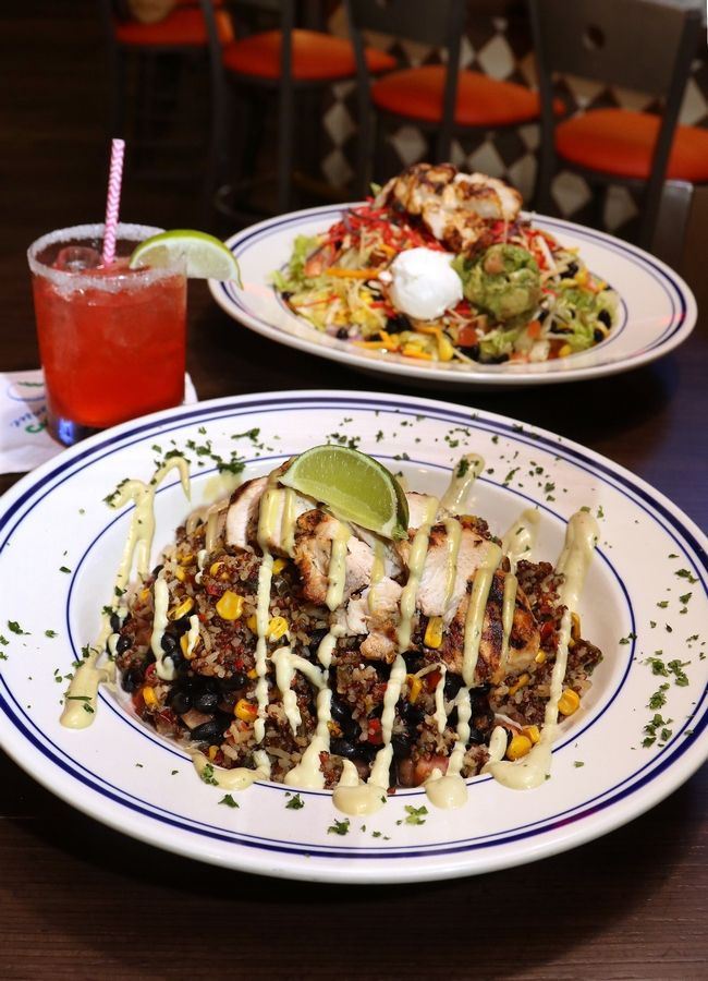 Murray Bros. Caddyshack serves up hearty dishes like the Chipotle Lime Quinoa Bowl, front, It's A Fiesta salad and a Master's Champion Strawberry Margarita at the Rosemont restaurant.