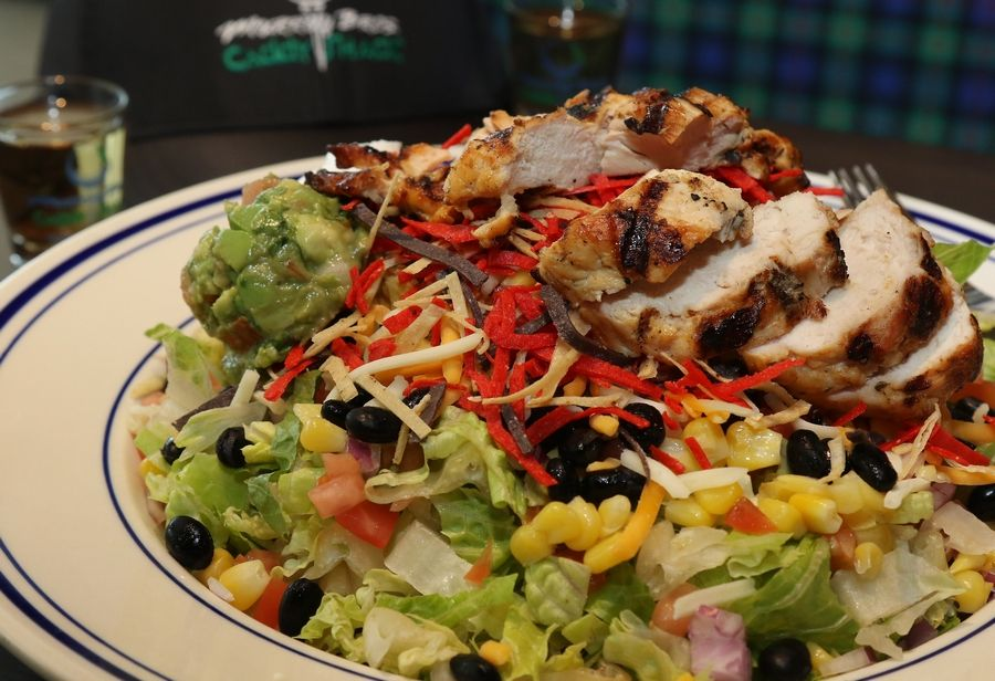 Murray Bros.' It's A Fiesta salad is loaded with black beans, corn, onions and tomatoes and is served with guacamole, sour cream and cumin ranch dressing.