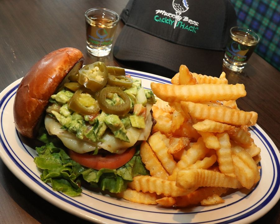 Murray Bros.'s bacon guacamole deluxe burger comes piled high with fixings.
