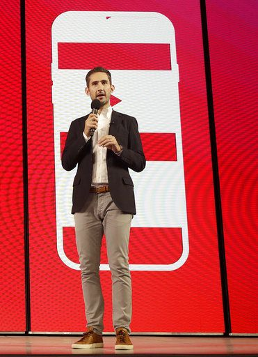 In this Tuesday, June 19, 2018, photo Kevin Systrom, CEO and co-founder of Instagram, prepares for Wednesday's announcement about IGTV in San Francisco. Facebook's Instagram app is loosening its restraints on video with a new channel that will attempt to lure younger viewers away from Google's YouTube and pave the way to sell more advertising.