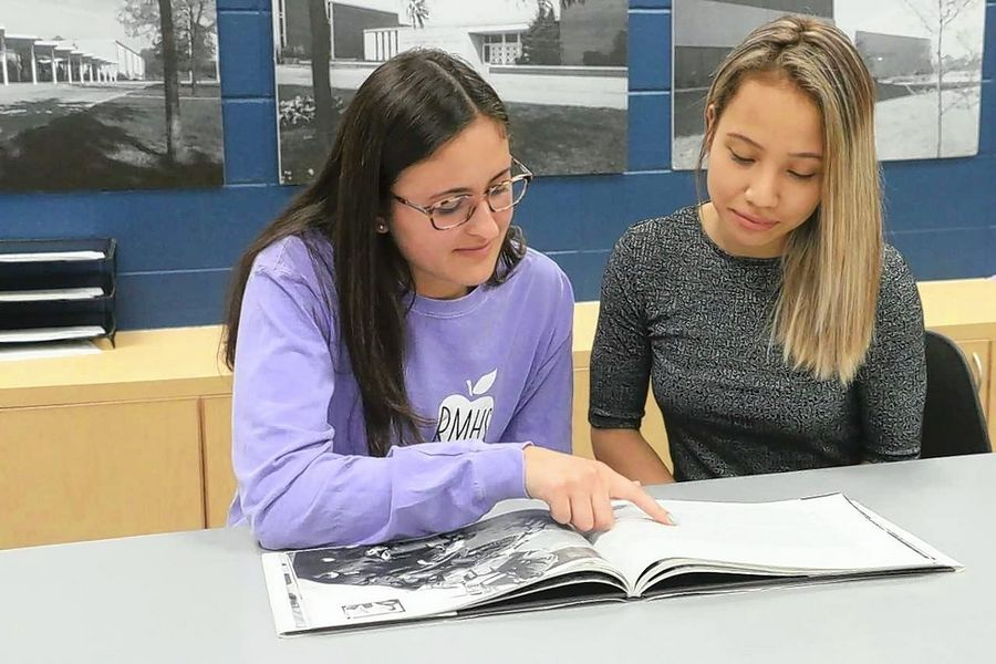 Allie Ontaneda, left, and Jasmine Bautista, right, participated in District 214's education pathway and took the Education Academy course before they graduated in May.