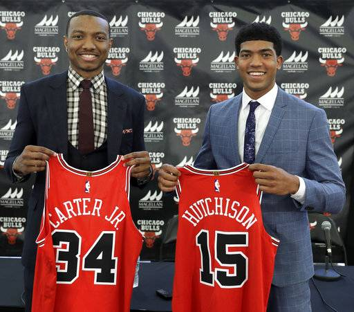 The Chicago Bulls first round draft picks, Wendell Carter Jr., left, and Chandler Hutchison pose with their jerseys after an NBA basketball news conference where they were introduced to Chicago reporters Monday, June 25, 2018, in Chicago.