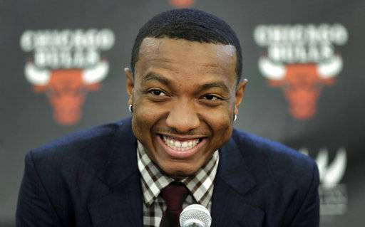 The Chicago Bulls first round draft pick, Wendell Carter Jr., smiles during an NBA basketball news conference where he was introduced to Chicago reporters Monday, June 25, 2018, in Chicago.