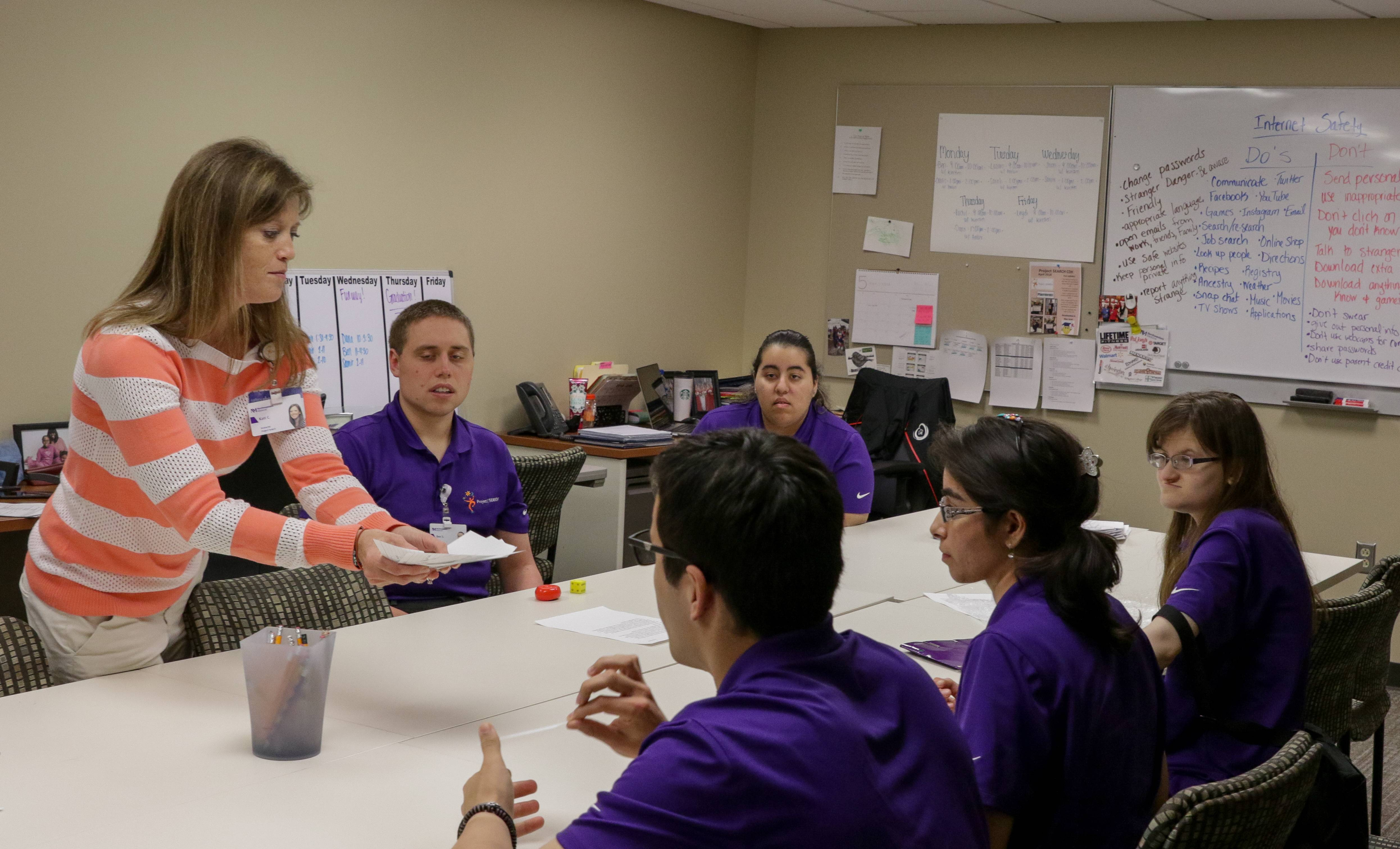 Kati Curby, a special education instructor, teaches Project SEARCH interns a lesson about internet safety in a classroom at Central DuPage Hospital in Winfield.