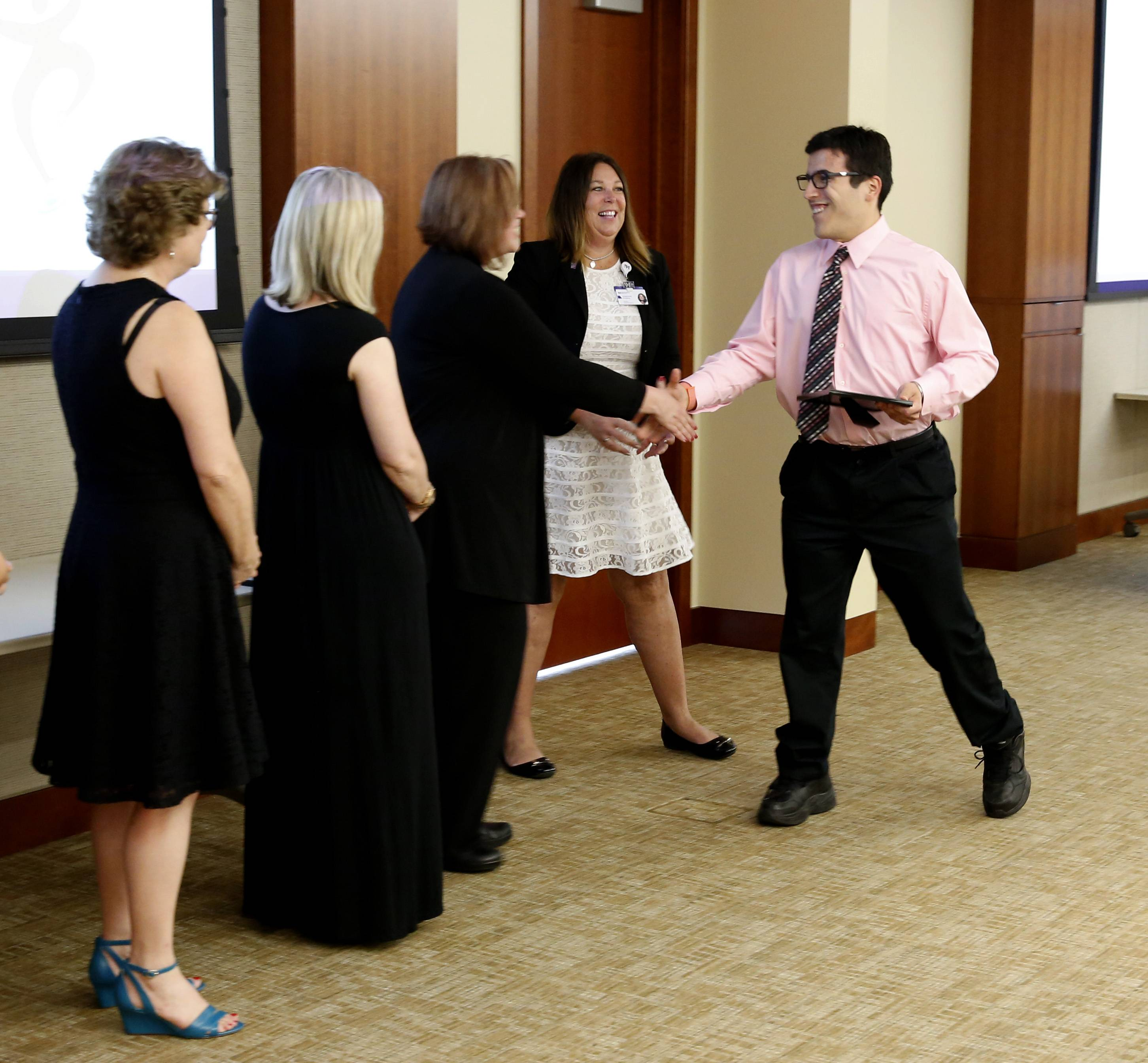 "Jhon Castillo celebrates with his class of interns at Central DuPage Hospital. He landed a job as a customer service representative for the West Chicago Park District. ""I feel like a achieved a goal,"" the 19-year-old said."
