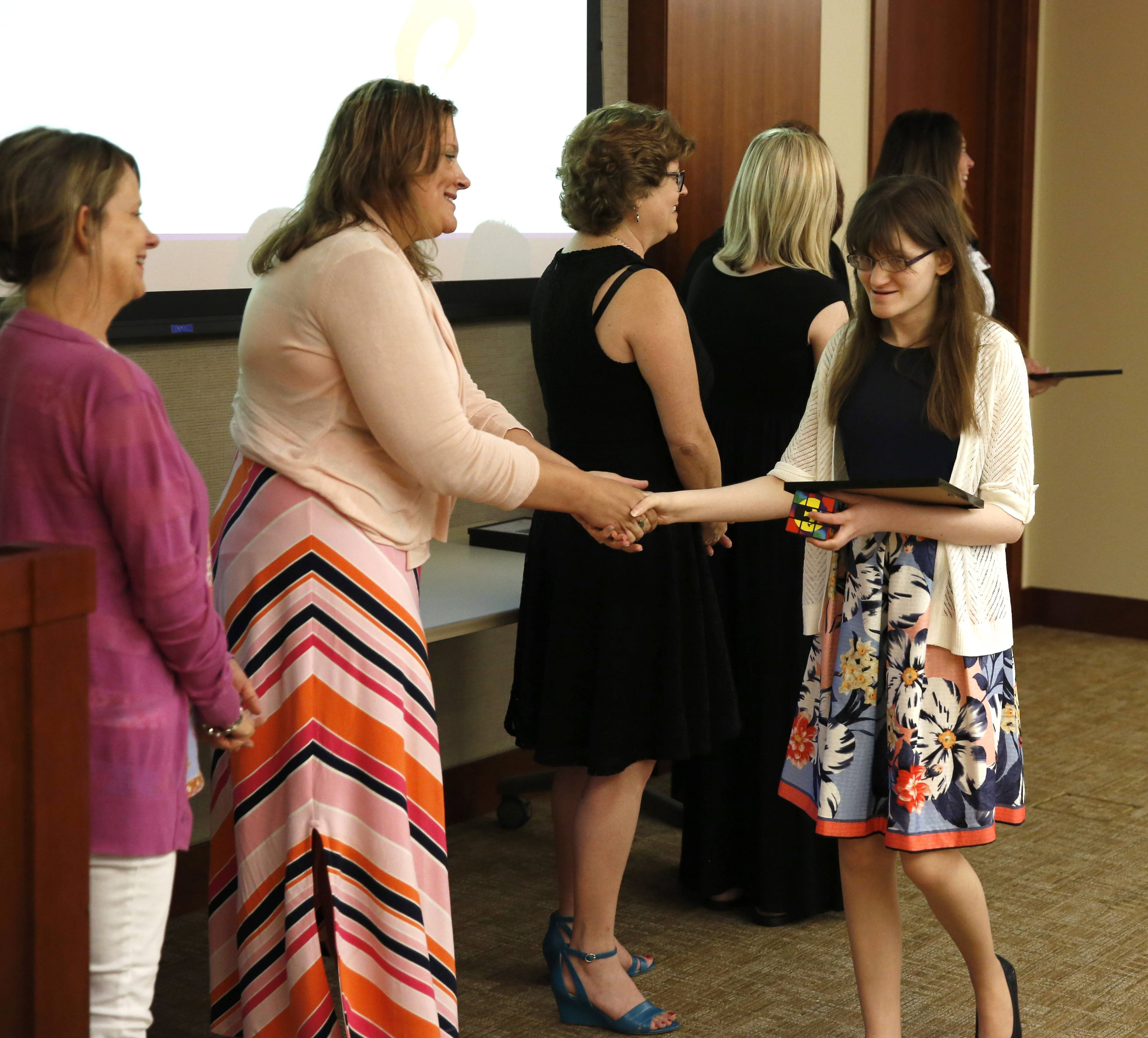 Sarah Grippando accepts her certificate in front of an audience of family, friends and internship supervisors at Central DuPage Hospital.