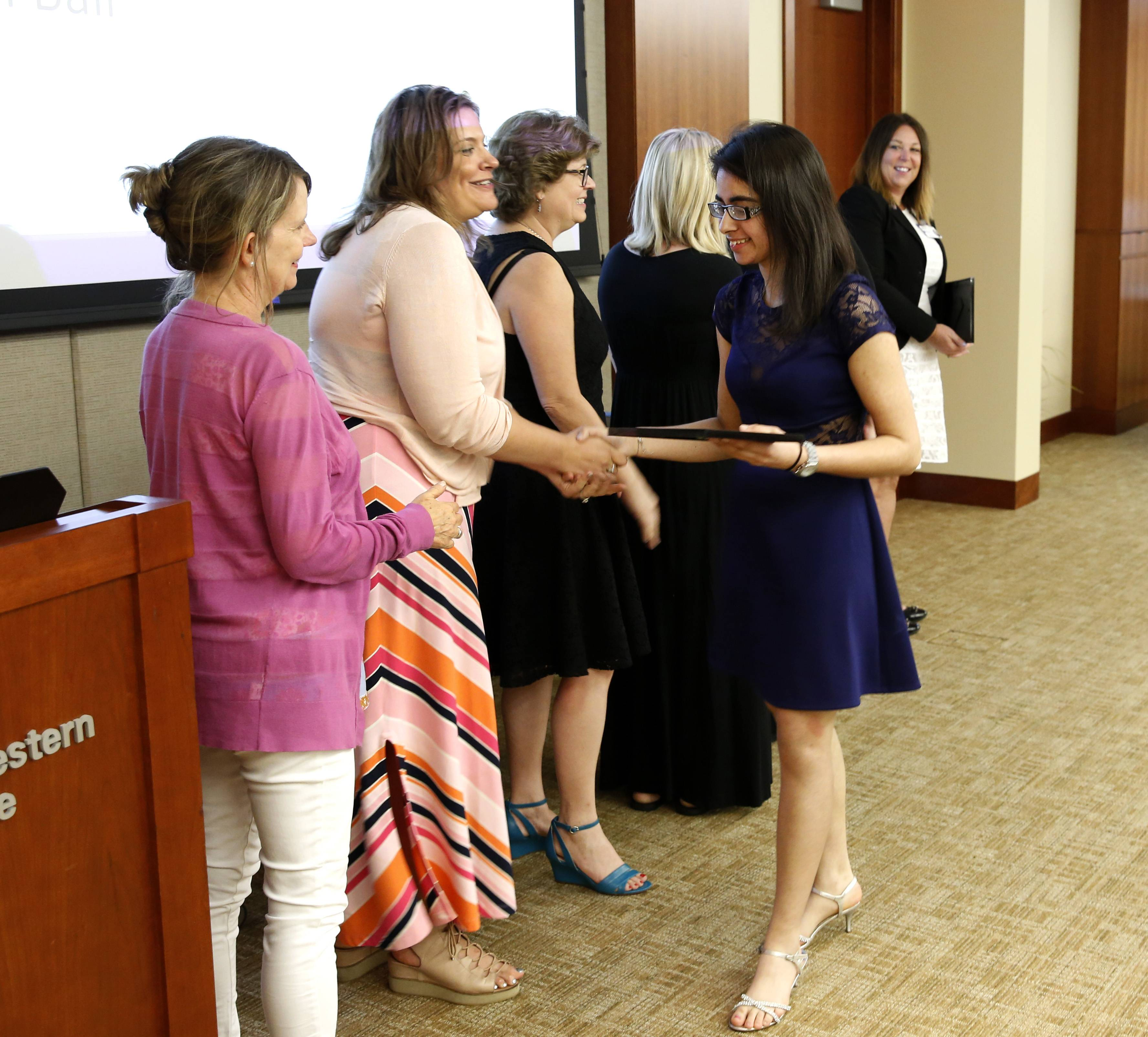 Rachel Bali collects her diploma as a 2018 graduate of the Project SEARCH job training program at Central DuPage Hospital.