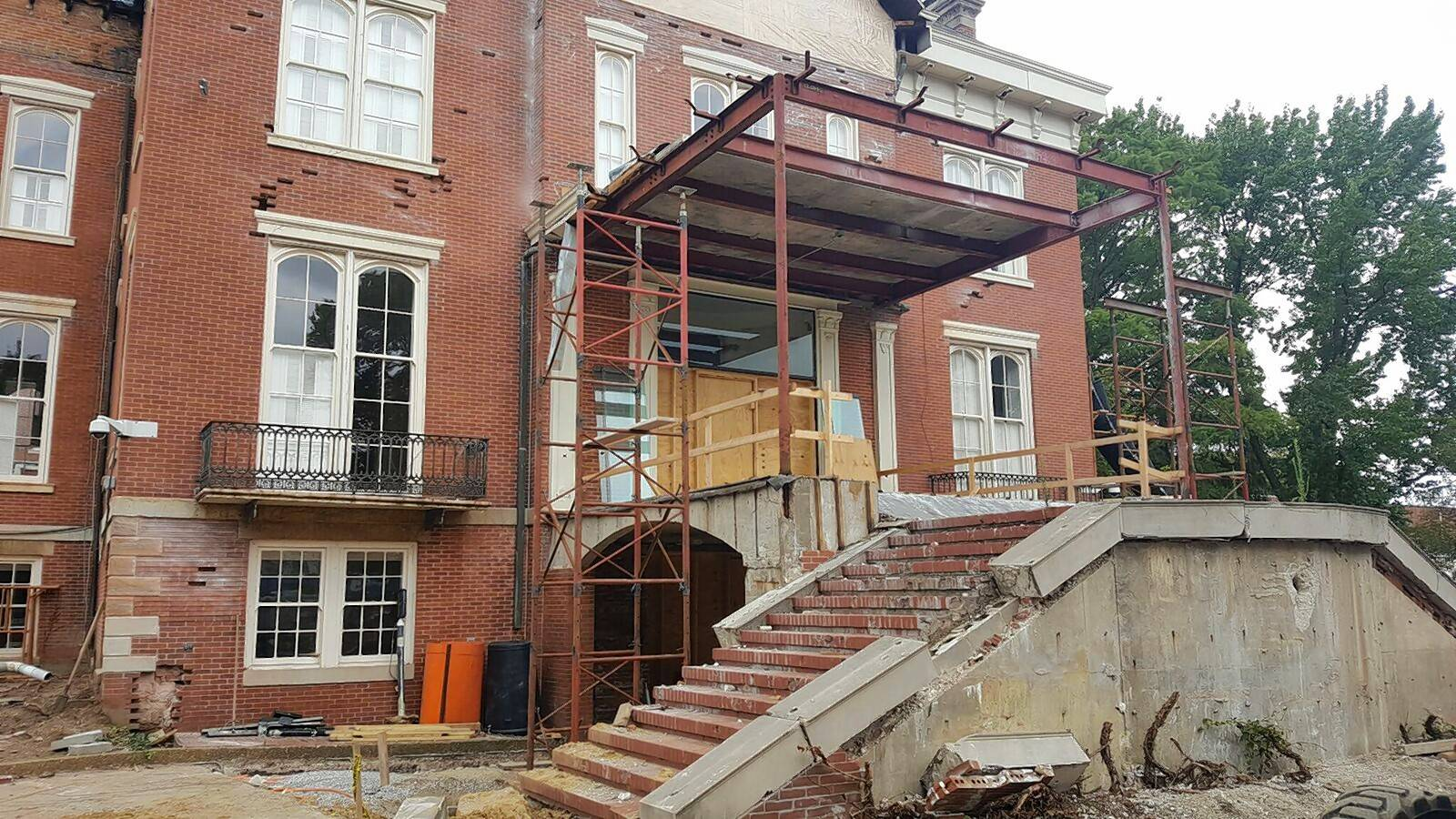 The Governor's Mansion during exterior repairs to the brickwork and foundation walls.