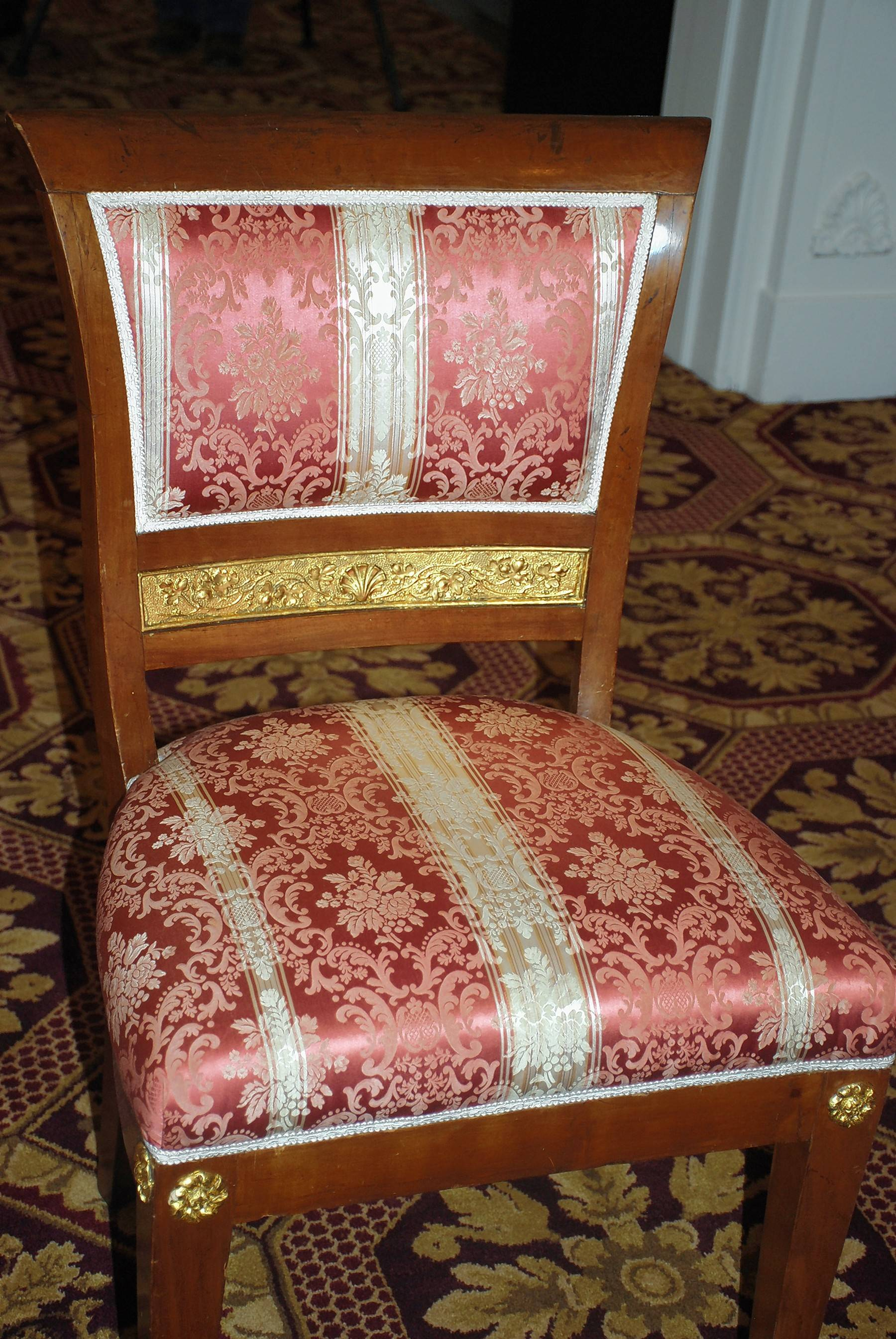 An example of the antique chairs found around the mansion that have been refinished and reupholstered for active use into the future.