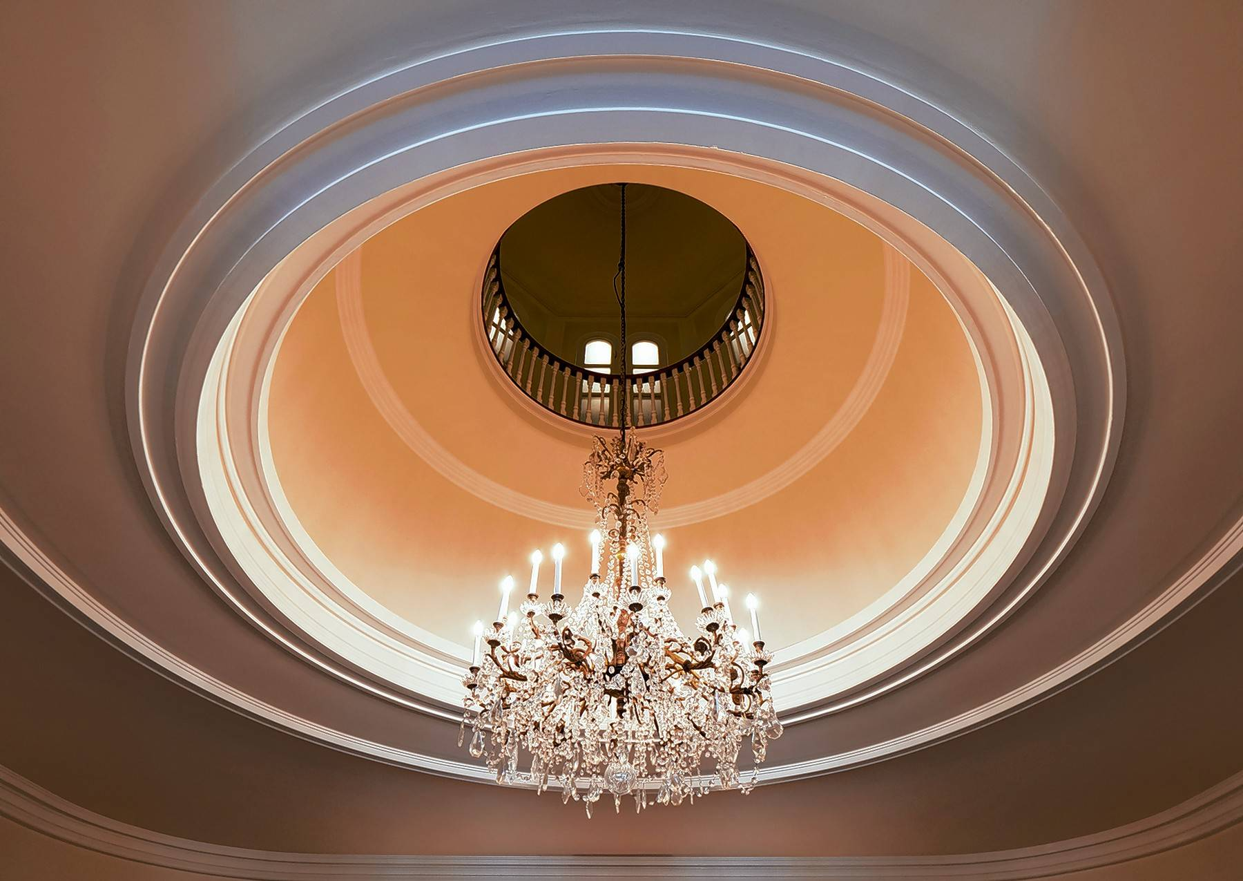 A chandelier at the top of the mansion's circular staircase.