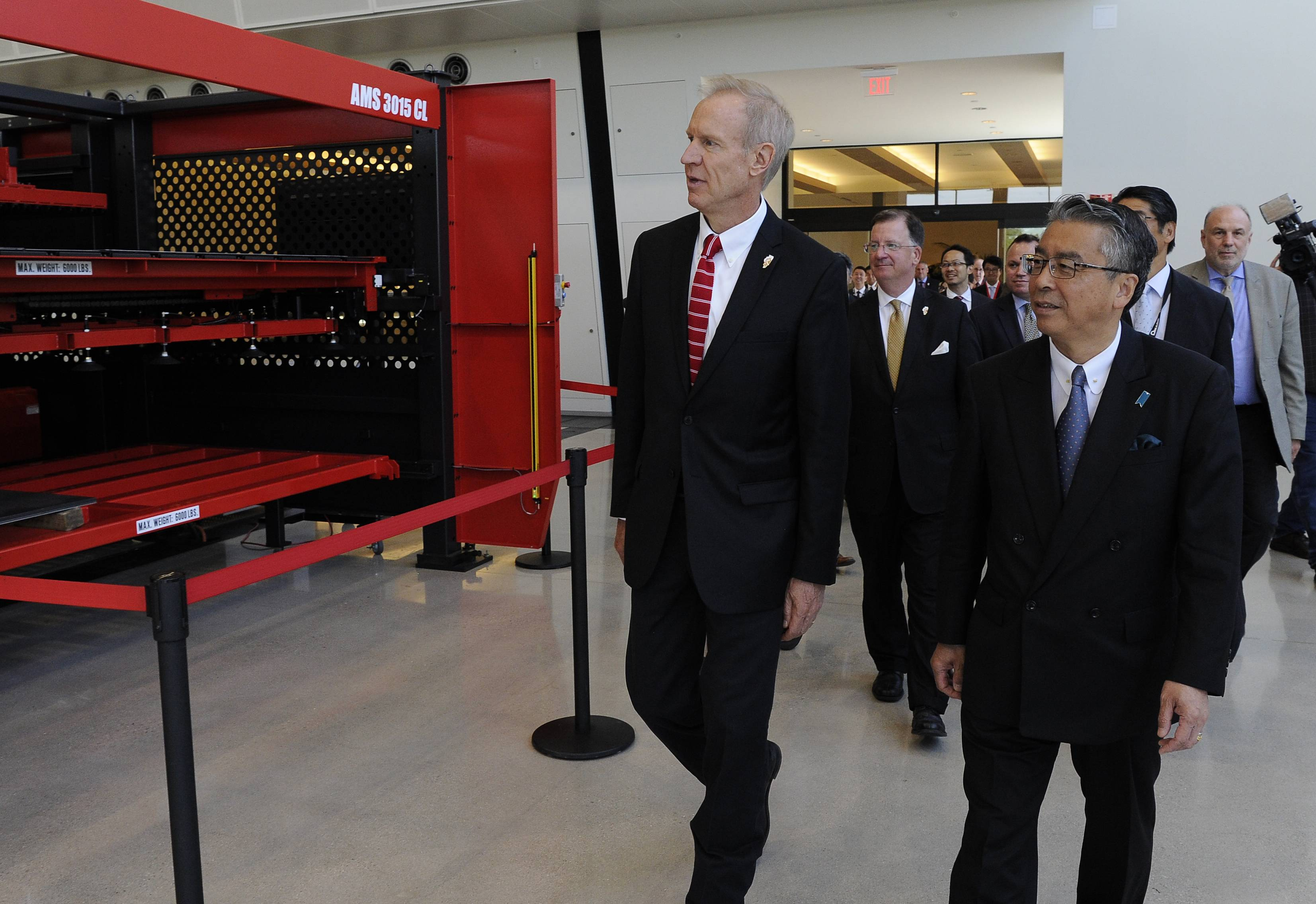 Gov. Bruce Rauner walks into the Amada America, Inc. plant in Schaumburg with Japanese Ambassador Shinsuke Sugiyama and other dignitaries for a tour Tuesday.