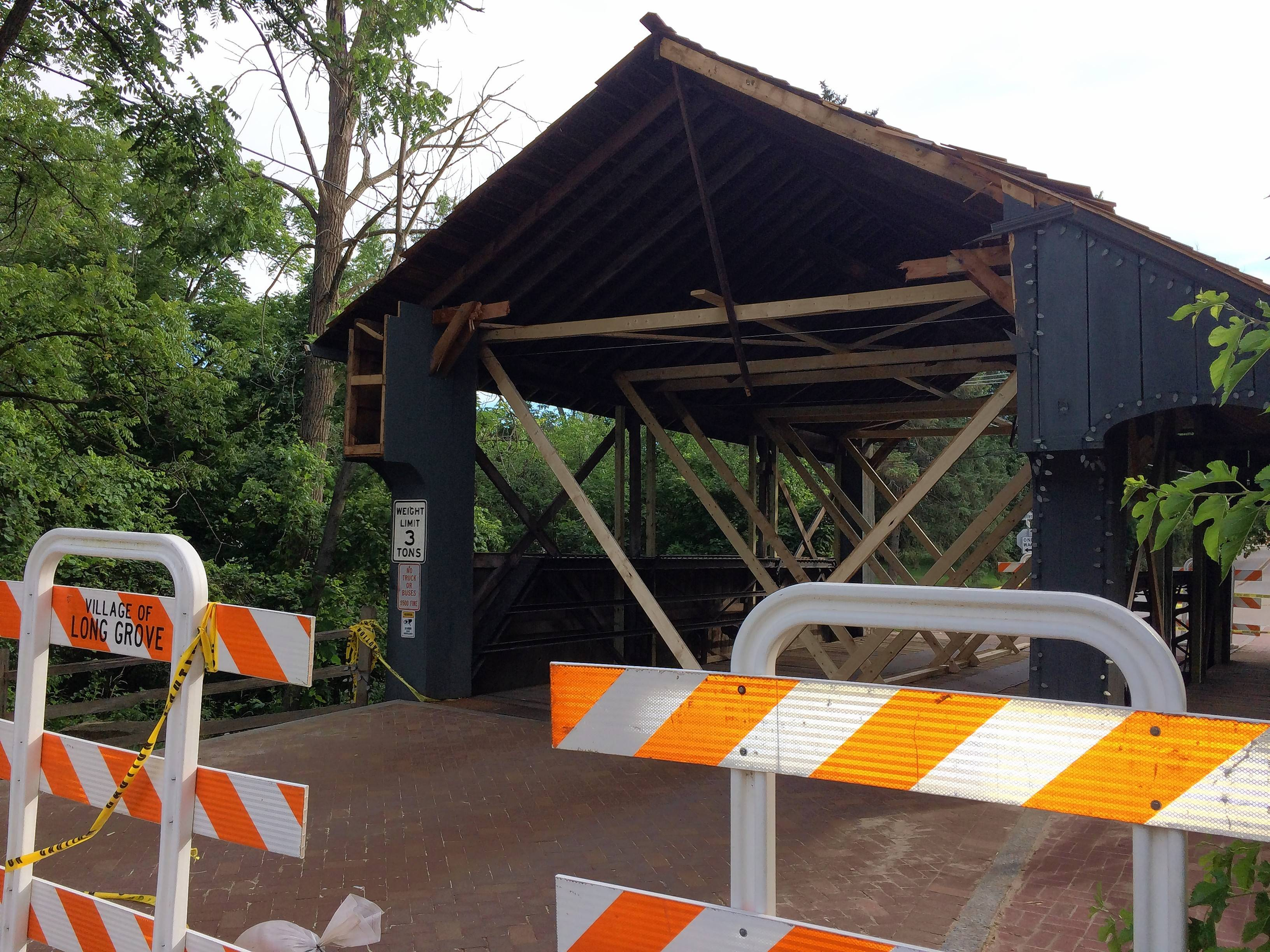 Long Grove's iconic covered bridge will be closed into next year to accommodate repairs to the span that sustained heavy damage due to a truck smashing through it soon after it became a national landmark in June, officials said at a village board meeting Tuesday night.