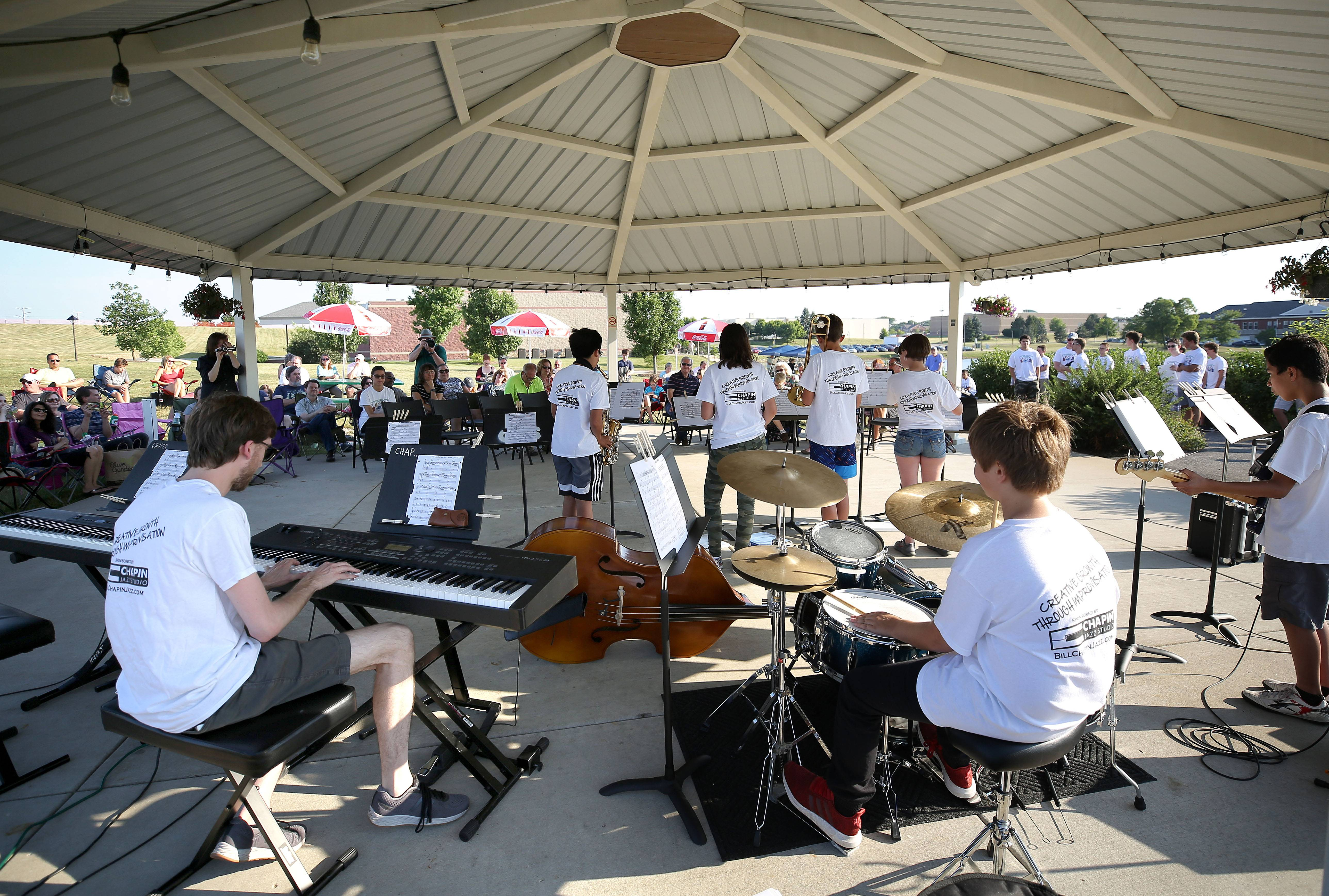 Student musicians from the Grayslake Jazz Combo Workshop play Wednesday night in the gazebo during the Midweek Break on the Lake at the Round Lake Beach Cultural Center.