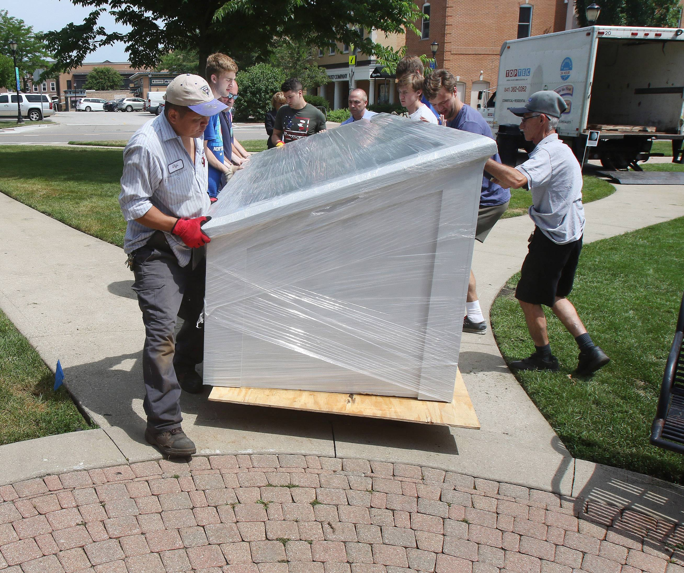 A work crew for Founders 55 installs a replica of the Charters of Freedom exhibit Wednesday at Cook Park in Libertyville.