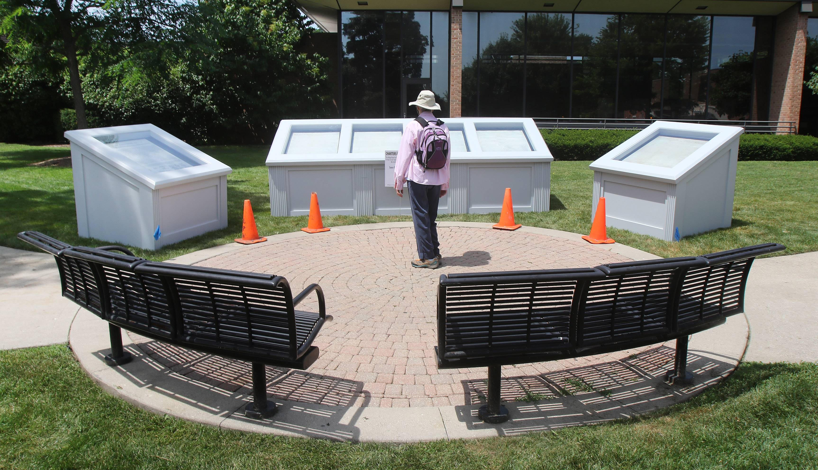 A woman stops to look at a replica of the Charters of Freedom exhibit installed on Wednesday at Cook Park in Libertyville.