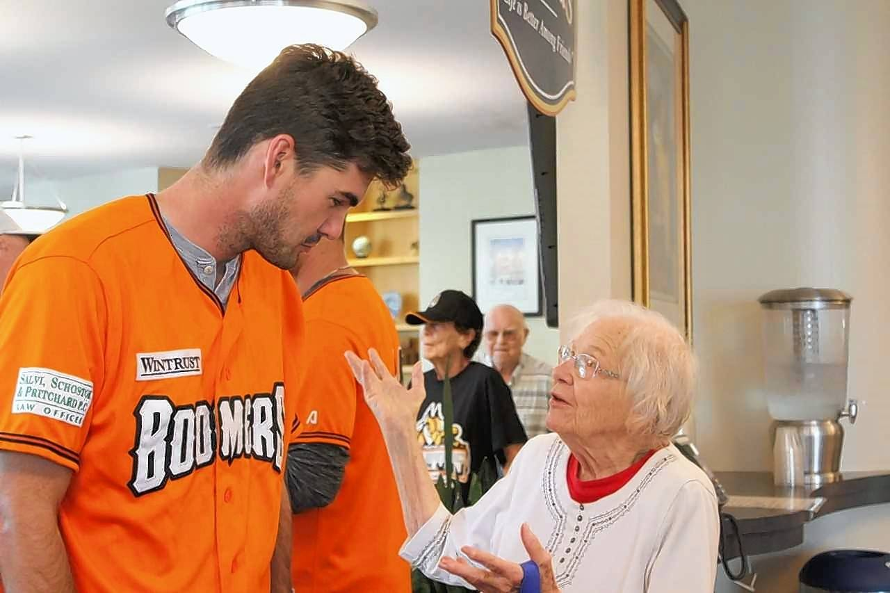 Schaumburg Boomers outfielder Clint Hardy chats with Mittie Dick, a resident of Friendship Village of Schaumburg, where Hardy's teammates Will Stillman, Collin Ferguson and Kenny Towns are living this summer.
