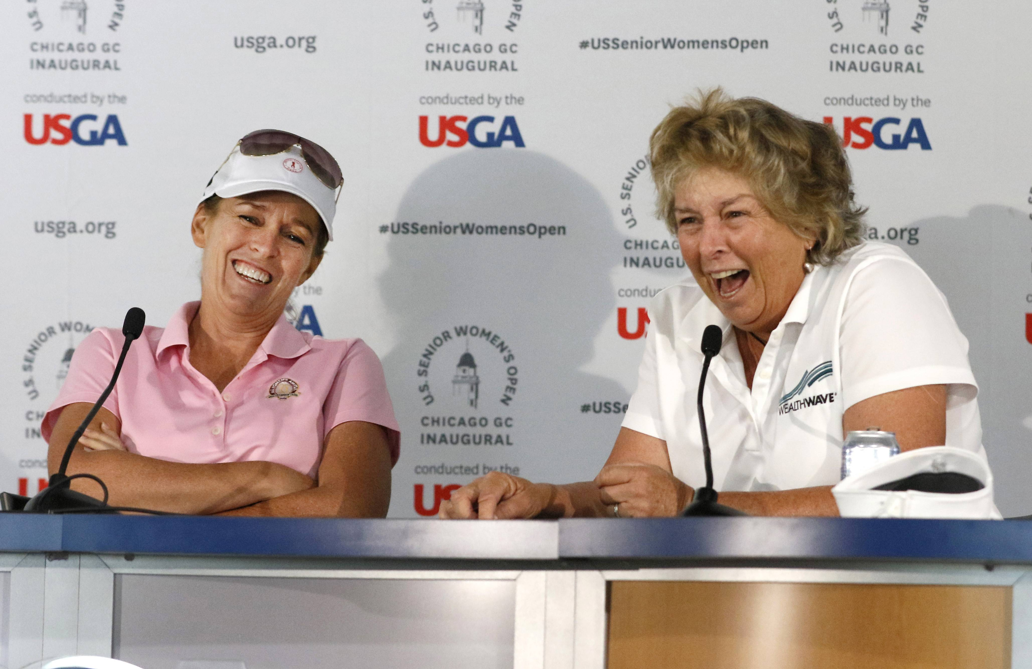 Daniel White/dwhite@dailyherald.comU.S. Senior Women's Open golfers Martha Leach, left, and her sister Hollis Stacy, right, talk about the inaugural U.S. Senior Women's Open at the Chicago Golf Club in Wheaton.