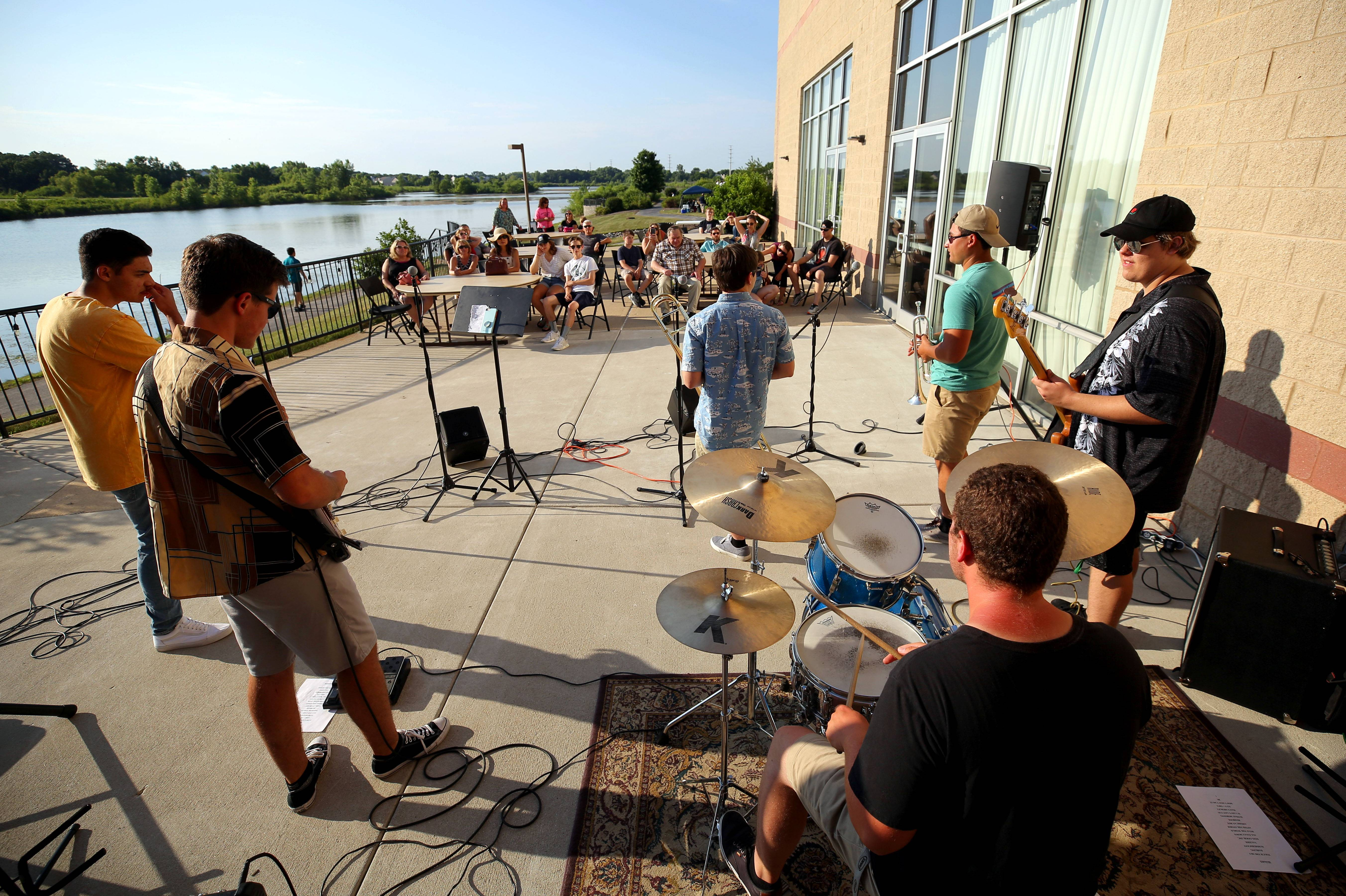 The band Better Than The Last Time entertains Wednesday on the veranda during the Midweek Break on the Lake at the Round Lake Beach Cultural Center.