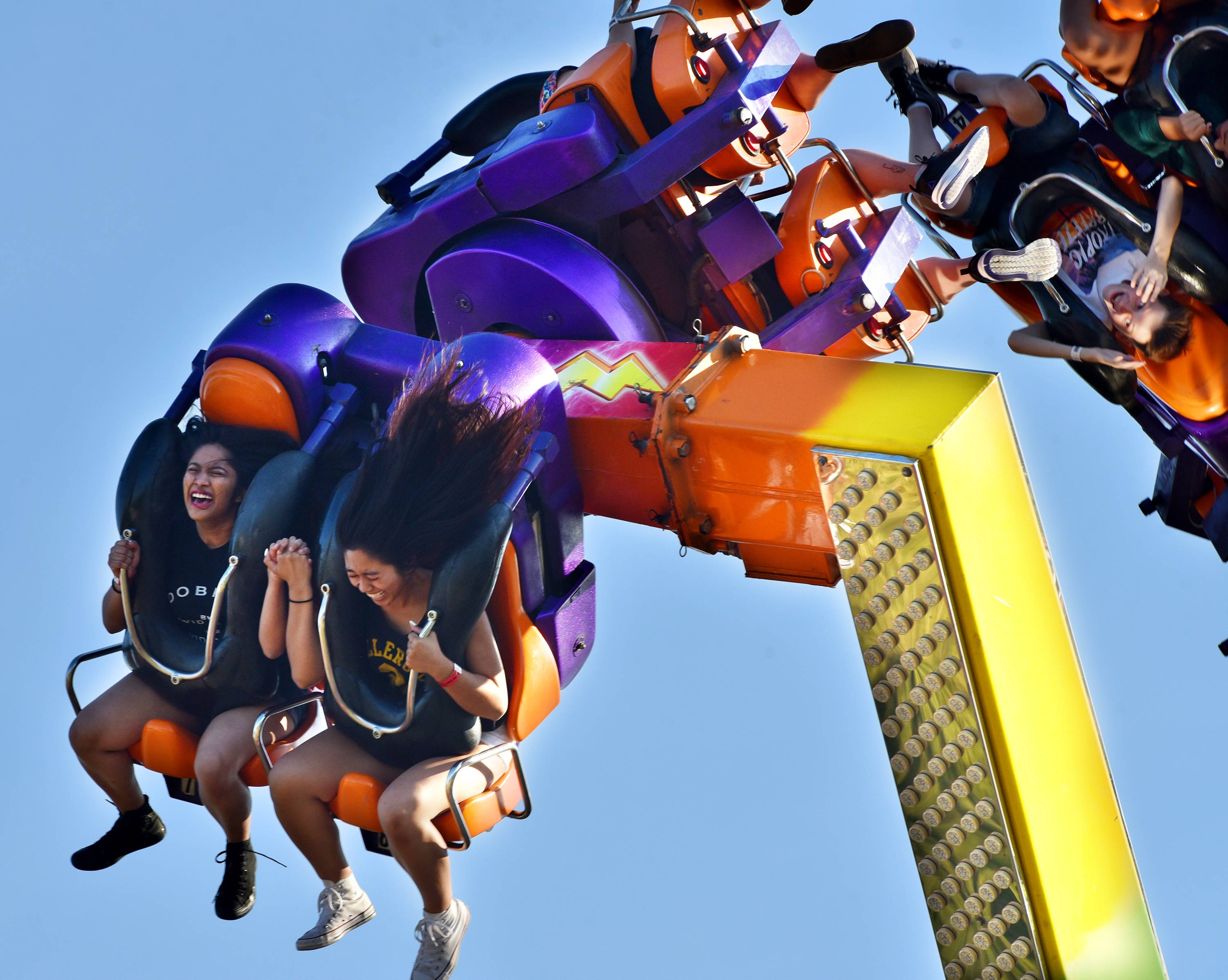 Riders laugh on the Power Surge at the Glendale Heights Fest Wednesday evening.