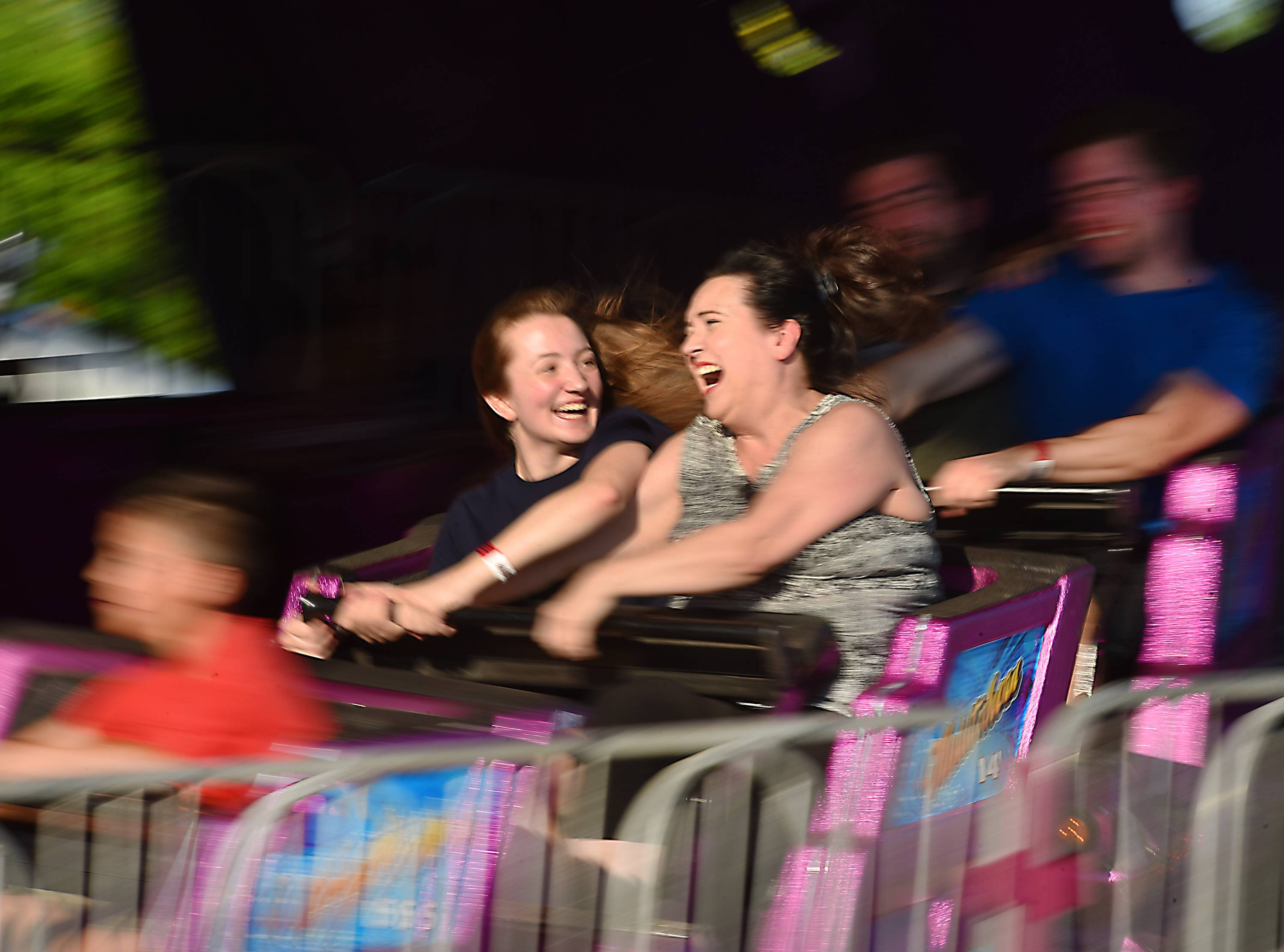 Shelly Banks looks at her mother Martha as they hang on to the spinning Matterhorn ride at the Glendale Heights Fest opening night Wednesday evening. They are from Bartlett.