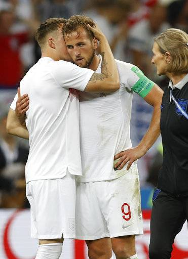England's Eric Dier hugs with England's Harry Kane, right, during the semifinal match between Croatia and England at the 2018 soccer World Cup in the Luzhniki Stadium in Moscow, Russia, Wednesday, July 11, 2018.