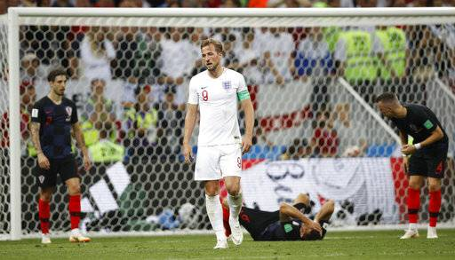 England's Harry Kane grimaces during the semifinal match between Croatia and England at the 2018 soccer World Cup in the Luzhniki Stadium in Moscow, Russia, Wednesday, July 11, 2018.