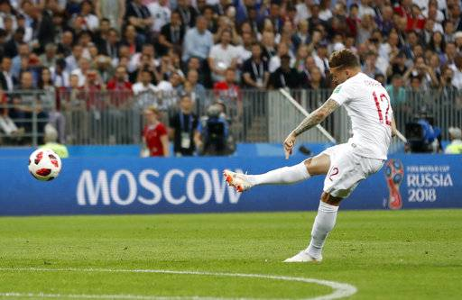 England's Kieran Trippier scores the opening goal during the semifinal match between Croatia and England at the 2018 soccer World Cup in the Luzhniki Stadium in Moscow, Russia, Wednesday, July 11, 2018.