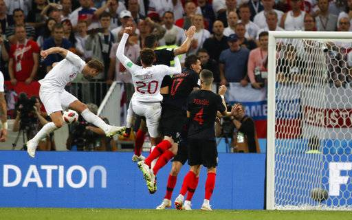 England's Harry Kane, left, fails to score during the semifinal match between Croatia and England at the 2018 soccer World Cup in the Luzhniki Stadium in Moscow, Russia, Wednesday, July 11, 2018.