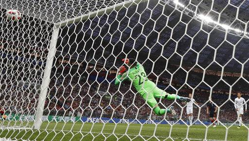England's Kieran Trippier beats Croatia goalkeeper Danijel Subasic to score the opening goal from a free kick during the semifinal match between Croatia and England at the 2018 soccer World Cup in the Luzhniki Stadium in Moscow, Russia, Wednesday, July 11, 2018.