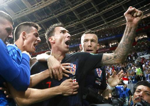 Croatia's Mario Mandzukic, center, celebrates after scoring his side's second goal during the semifinal match between Croatia and England at the 2018 soccer World Cup in the Luzhniki Stadium in Moscow, Russia, Wednesday, July 11, 2018.