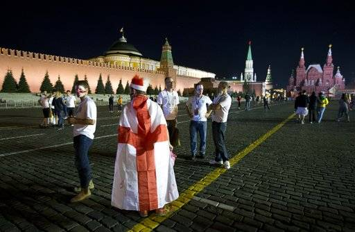 England fans stand in Red Square after the semifinal soccer match between Croatia and England during the 2018 soccer World Cup in Moscow, Russia, Thursday, July 12, 2018.