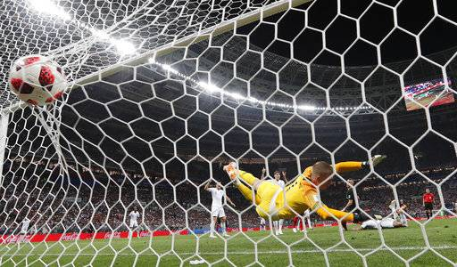 Croatia's Ivan Perisic scores his side's first goal past England goalkeeper Jordan Pickford during the semifinal match between Croatia and England at the 2018 soccer World Cup in the Luzhniki Stadium in Moscow, Russia, Wednesday, July 11, 2018.