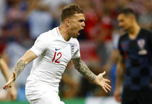 England's Kieran Trippier celebrates after scoring the opening goal during the semifinal match between Croatia and England at the 2018 soccer World Cup in the Luzhniki Stadium in Moscow, Russia, Wednesday, July 11, 2018.