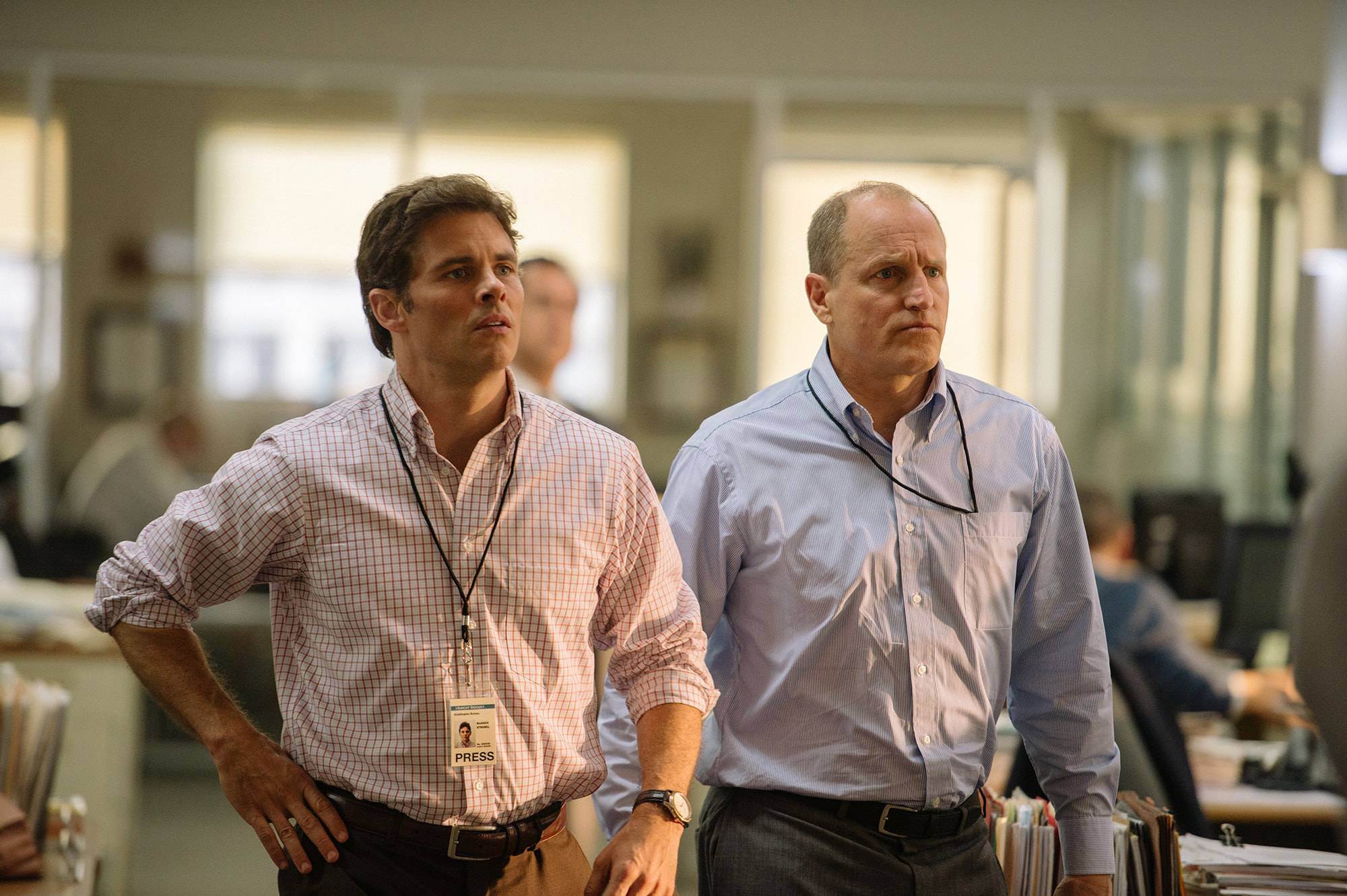 "Two Knight Ridder reporters (James Marsden, left, and Woody Harrelson) try to nail down Bush administration claims that Saddam Hussein was hiding weapons of mass destruction in ""Shock and Awe."""