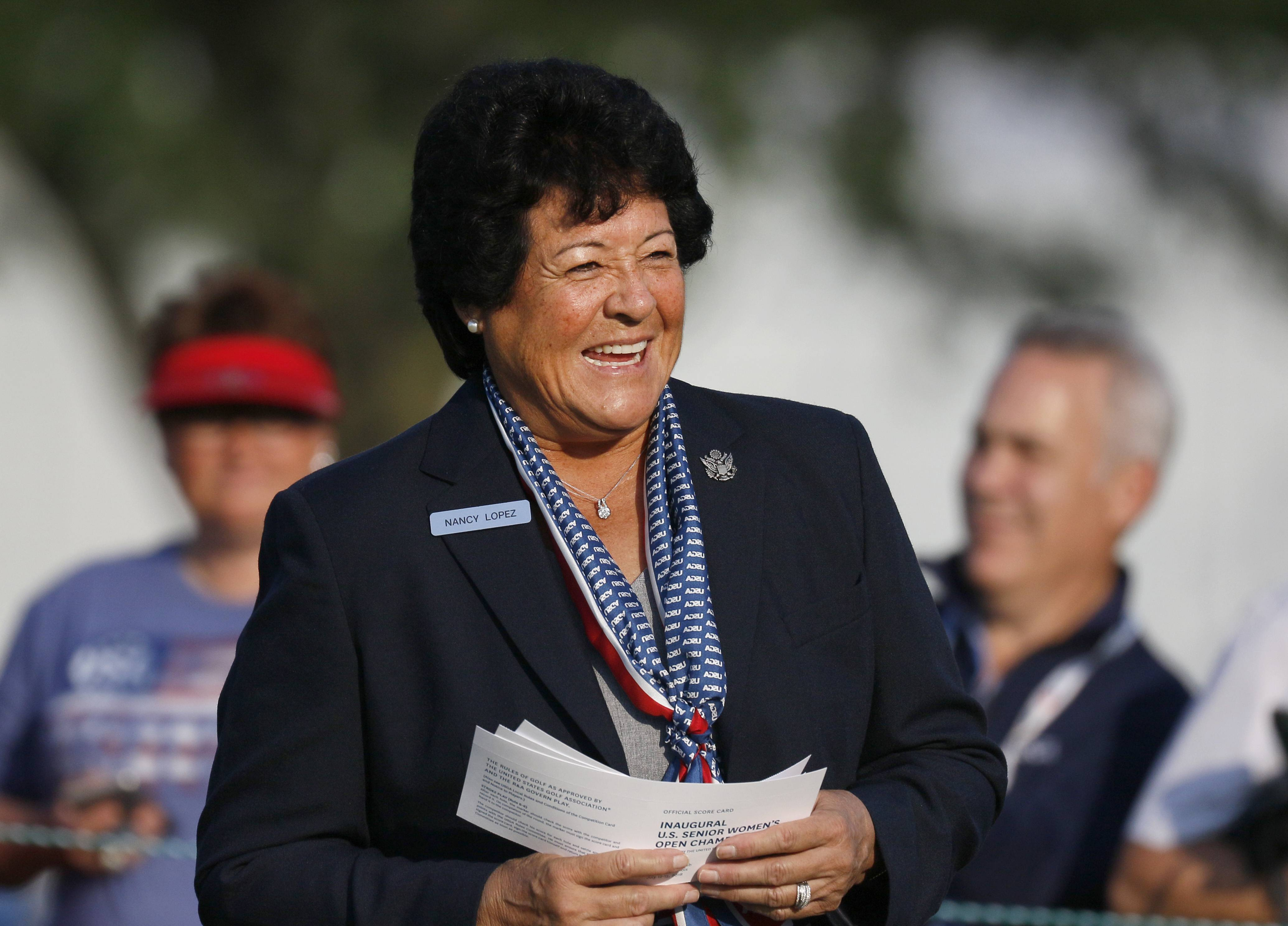As honorary starter, Nancy Lopez announces golfers at the first tee during the opening round of the inaugural U.S. Senior Women's Open Championship at the Chicago Golf Club in Wheaton.