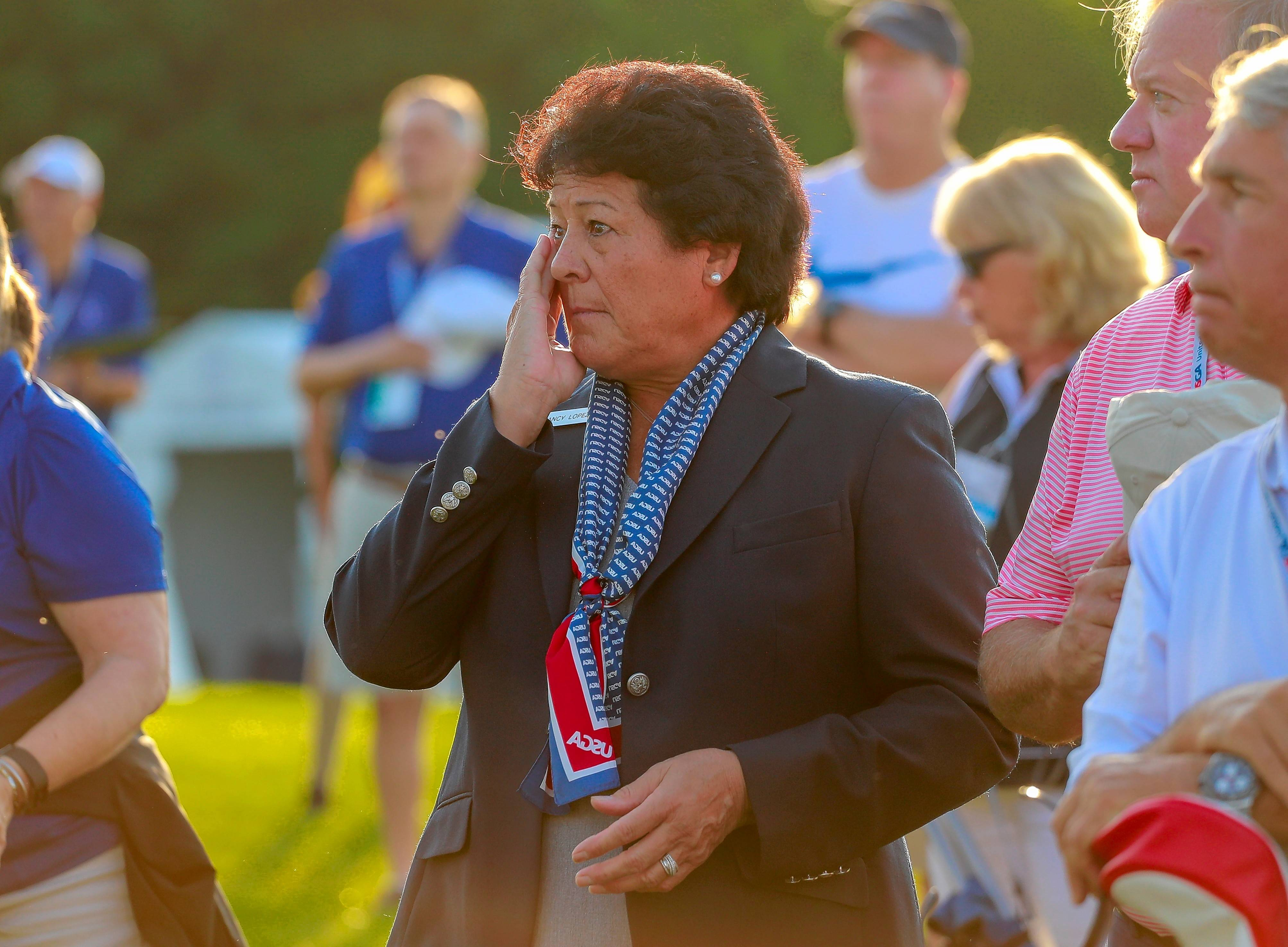 Nancy Lopez wipes away tears at the opening ceremony of the U.S. Senior Women's Open Thursday morning at Chicago Golf Club in Wheaton.