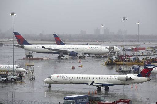 FILE- In this March 2, 2018, file photo, Delta Air Lines planes are grounded in New York. Delta Air Lines reports earns on Thursday, July 12.