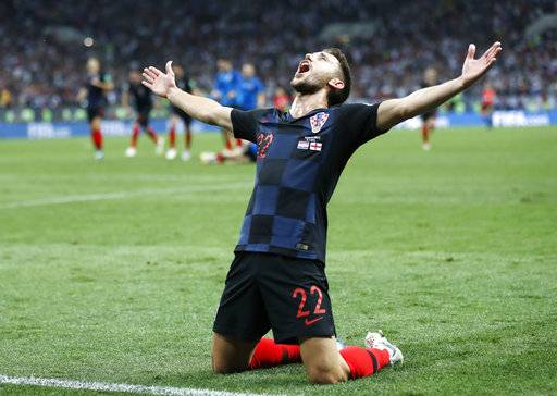 Croatia's Josip Pivaric celebrates after his team advanced to the final during the semifinal match between Croatia and England at the 2018 soccer World Cup in the Luzhniki Stadium in Moscow, Russia, Wednesday, July 11, 2018.