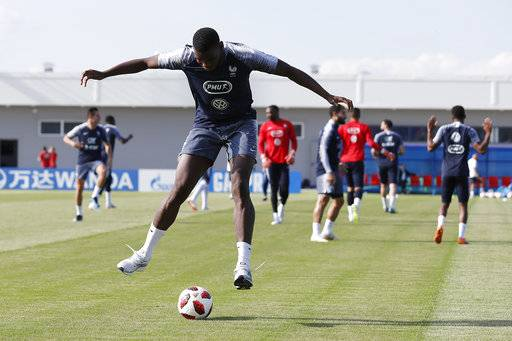 France's Paul Pogba dribbles the ball during a training session at the 2018 soccer World Cup in Glebovets, Russia, Thursday, July 12, 2018.