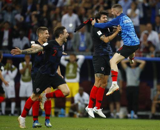 Players of Croatia celebrate after the semifinal match between Croatia and England at the 2018 soccer World Cup in the Luzhniki Stadium in Moscow, Russia, Wednesday, July 11, 2018.