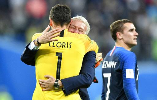 France goalkeeper Hugo Lloris celebrates with France head coach Didier Deschamps after their team advanced to the final after the semifinal match between France and Belgium at the 2018 soccer World Cup in the St. Petersburg Stadium in St. Petersburg, Russia, Tuesday, July 10, 2018.