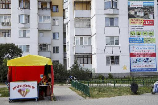 An ice cream seller waits for customers during the 2018 soccer World Cup at the in Nizhny Novgorod, Russia, Wednesday, July 4, 2018.
