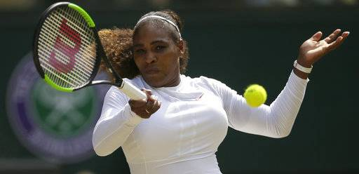 Serena Williams of the United States returns the ball to Germany's Julia Gorges during their women's singles semifinals match at the Wimbledon Tennis Championships, in London, Thursday July 12, 2018.