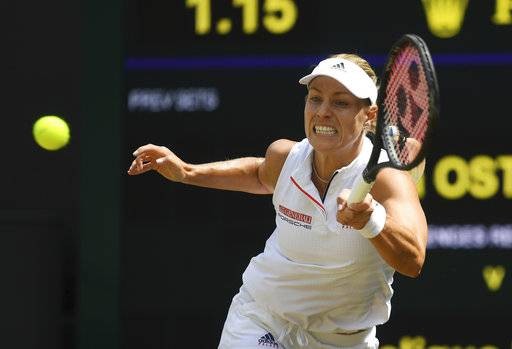 Angelique Kerber of Germany returns the ball to Jelena Ostapenko of Latvia during their women's semifinal match at the Wimbledon Tennis Championships in London, Thursday July 12, 2018. (Neil Hall/Pool via AP)