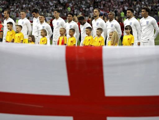 Team England stands behind the flag prior the semifinal match between Croatia and England at the 2018 soccer World Cup in the Luzhniki Stadium in Moscow, Russia, Wednesday, July 11, 2018.