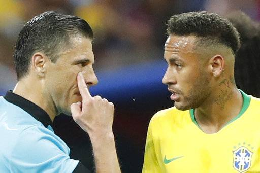 Referee Milorad Mazic from Serbia, left, gestures as he speaking to Brazil's Neymar during the quarterfinal match between Brazil and Belgium at the 2018 soccer World Cup in the Kazan Arena, in Kazan, Russia, Friday, July 6, 2018.