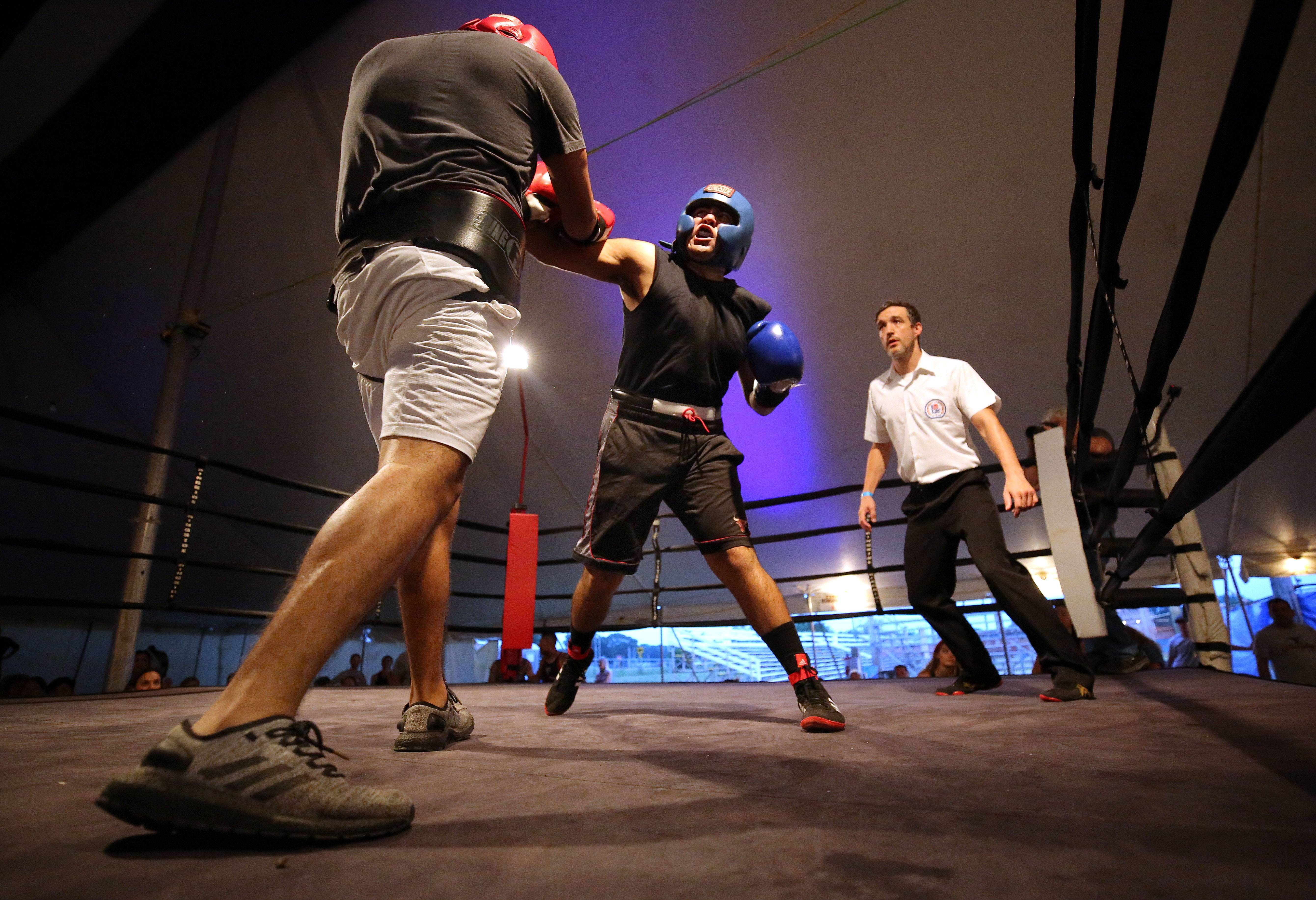 Omar Castro, right, and Eilas Miranda, both of Mundelein go toe-to-toe during the Badges vs. Bad Guys boxing event at the Wauconda Rodeo Friday night.
